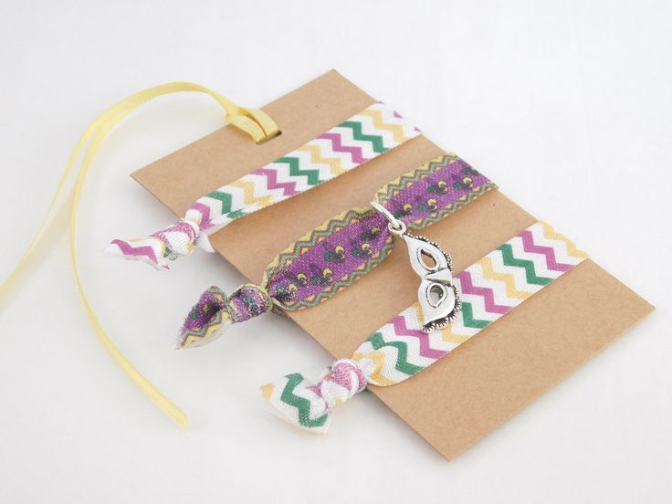 A personal favorite from my Etsy shop https://www.etsy.com/listing/571446550/mardi-gras-hair-ties-mardi-gras-party