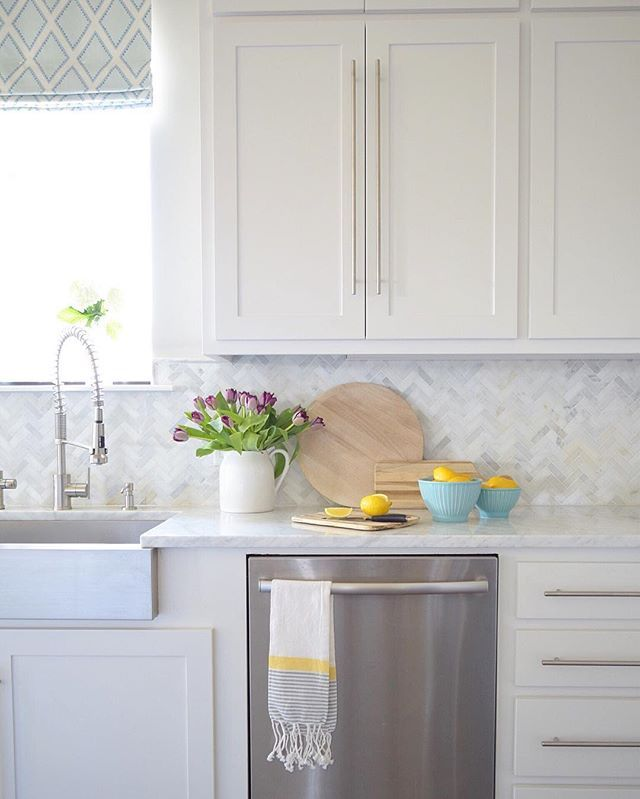 white kitchen + herringbone marble backsplash