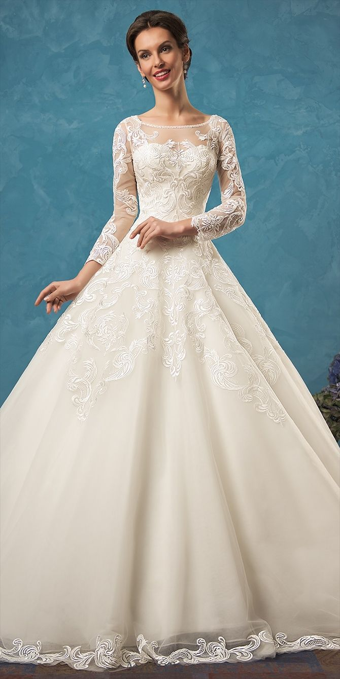 Dignity and grace that differ a classic silhouette from others are added with a trendy accent – massive lace that fully demonstrates its beauty on the back and long sleeves. Openwork patterns flow down the skirt and train claiming to be the main adornment.