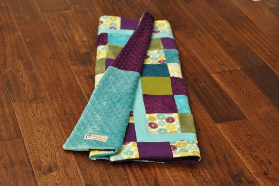 Adorable and modern baby girl quilt using purple, aqua and olive green fabrics.
