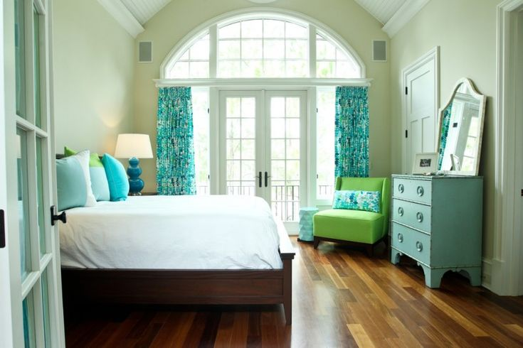 colors to paint your bedroom pale green walls bed pillows mirror wood floor doors windows curtains lamp beach style bedroom of Beautiful Colors to Paint Your Bedroom and Make It Look Charming