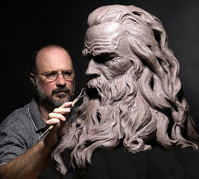Master Clay Sculptor, Philippe Faraut, at work on a piece.