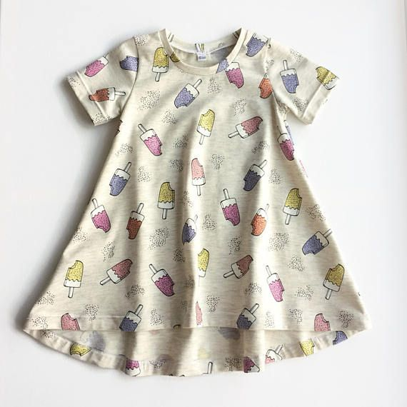 This summer dress will become probably become your girls favourite! The tshirt dress is super cute with sparkly popsicles. You can choose a beige background or light blue. All seams are serged for strength and durability. This dress can be made in the following sizes: 9 months (size 74) 12 months (size 80) 18 months (size 86) 2T (size 92) 3T (size 98) Care instructions: wash inside out on low temperature, do not tumble dry.