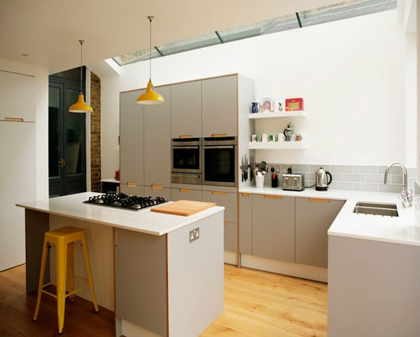 Grey formica kitchen and central island using birch ply