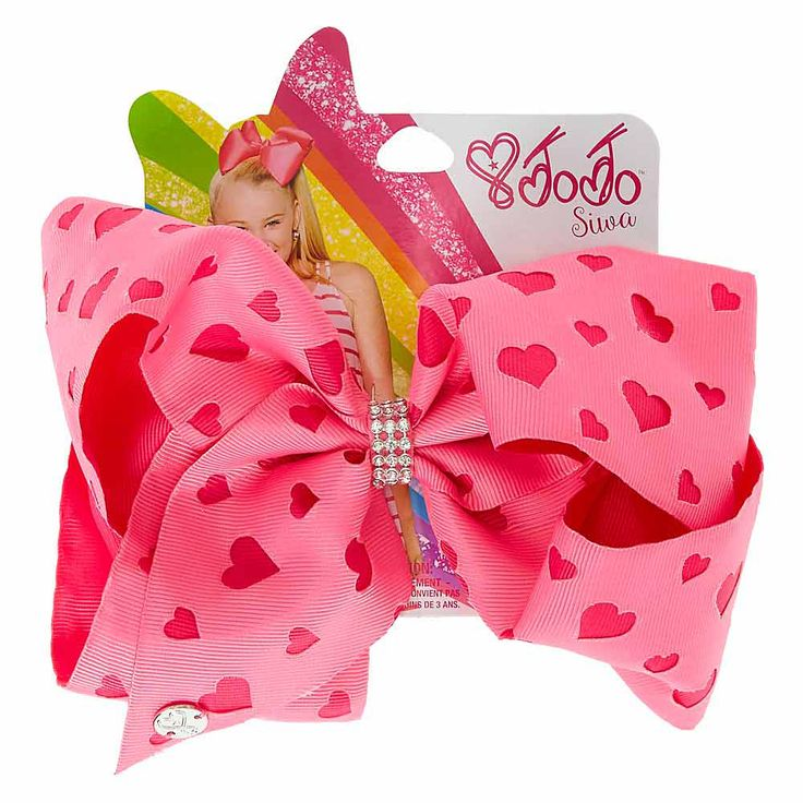 <P>Fall in LOVE with this pretty and pink colored signature hair bow from the JoJo Siwa collection! This special one is designed specifically for Valentine's Day. The two-tone pink bow features a lazer cut heart design and a rhinestone wrapped center! It's the perfect finishing touch to your Valentine's Day look!</P><P><STRONG>Hair bow</STRONG> by <STRONG>JoJo Siwa©&amp...
