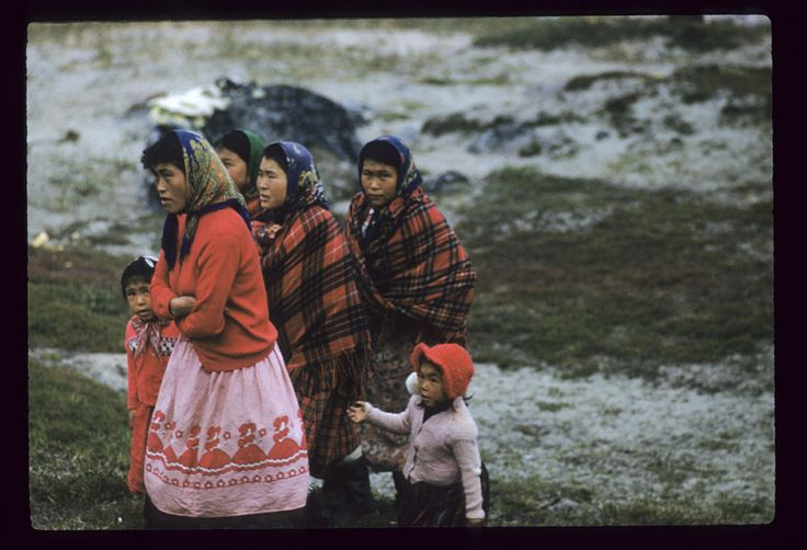 Four women and two children walking on a grassy hill, Kangiqsualujjuaq, Quebec. (item 1)