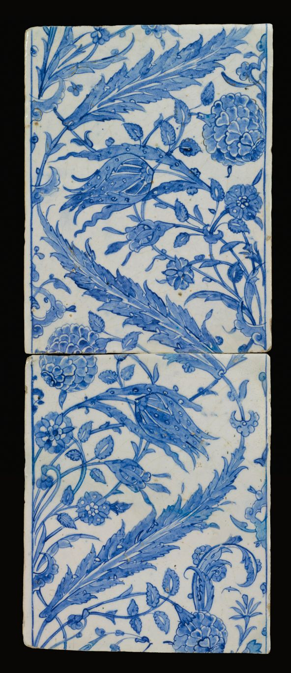 TWO OTTOMAN BLUE AND WHITE TILES, TURKEY OR SYRIA, LATE 16TH CENTURY each of rectangular form, decorated in cobalt blue, with issuing sprays of saz leaves, tulips, carnations and rosettes