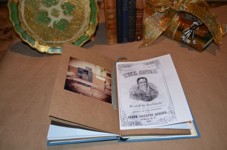 """Handcrafted """"Haunted Asylums"""" journal with original author photo and reproduction of the insane asylum's patient journal."""