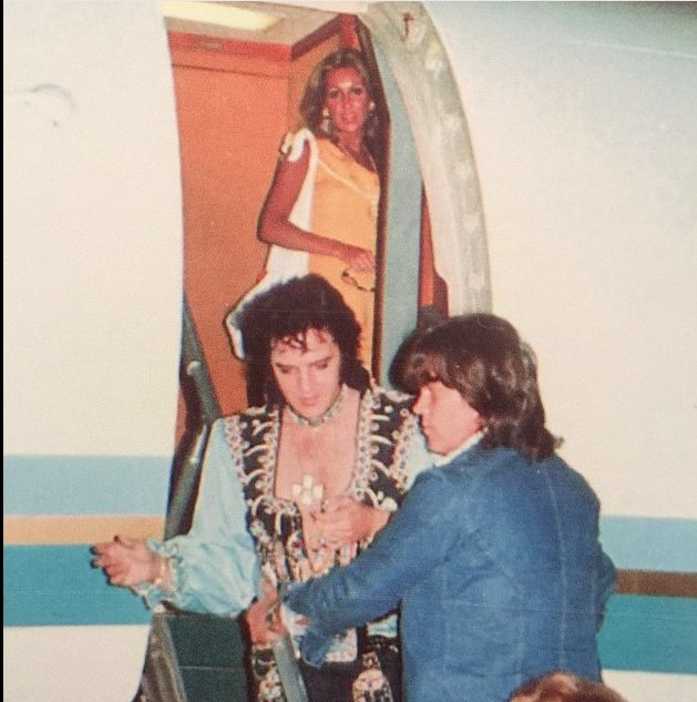 Linda Thompson Elvis and Sonny West, leaving the plane