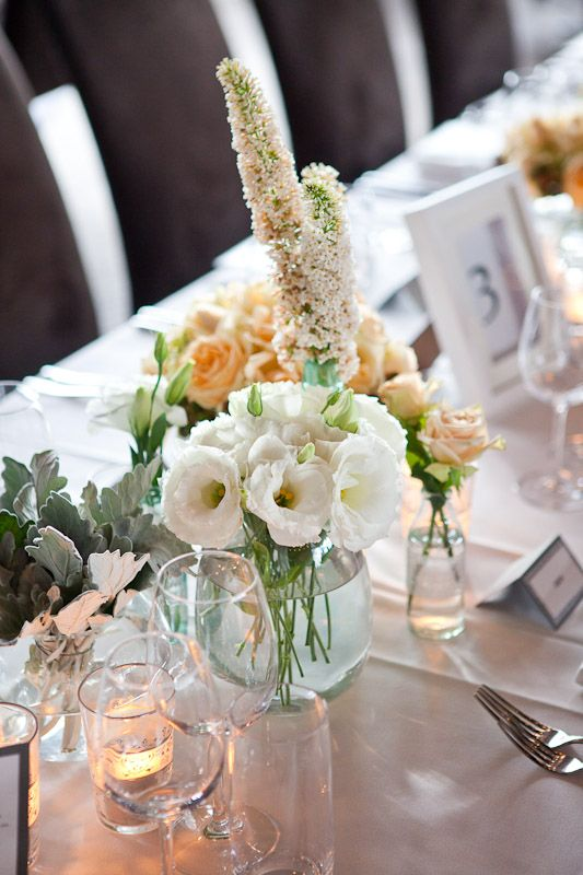 Cluster vase table arrangement. Styled by Greenstone Events.