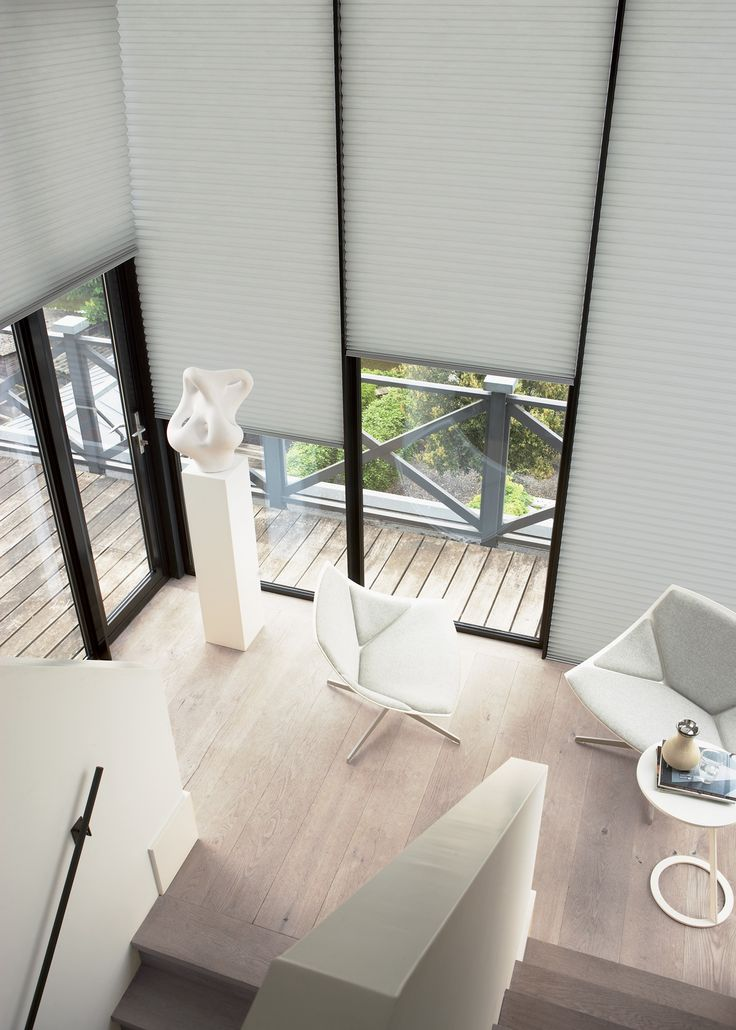 White Duette® honeycomb shades are a stylish and energy efficient solution perfect for large windows. *Hunter Douglas winodw treatments *Contemporary living room
