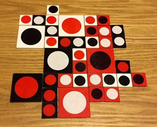RED: A three-player game. Your final score is product of the scores of your largest circle group and your largest border group--so both really matter.