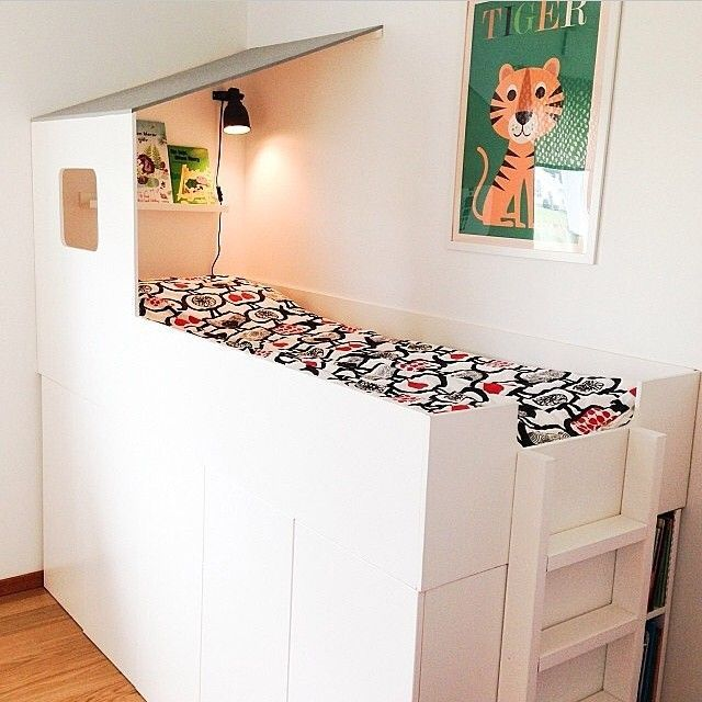 house shaped loft bed with storage cabinets underneath via mommodesigns