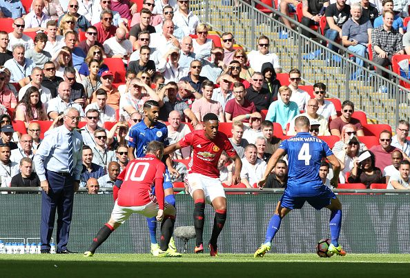 Danny Drinkwater of Leicester City in action with Antony Martial of Manchester United during the FA Community Shield Match between…