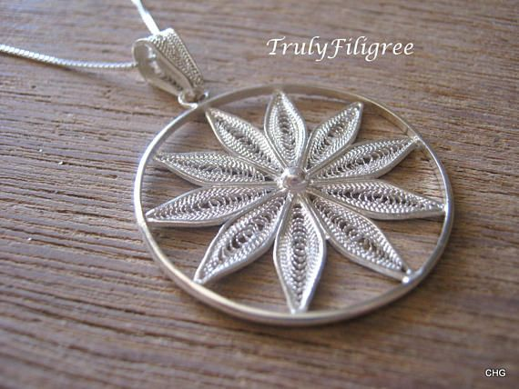 Check out this item in my Etsy shop https://www.etsy.com/uk/listing/525033553/flower-filigree-pendant-flower