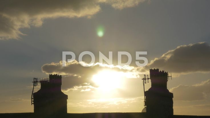 4k Sunset Time Lapse Behind Chimney Rooftop Silhouette Dusk Clouds Lens Flare - Stock Footage   by RyanJonesFilms