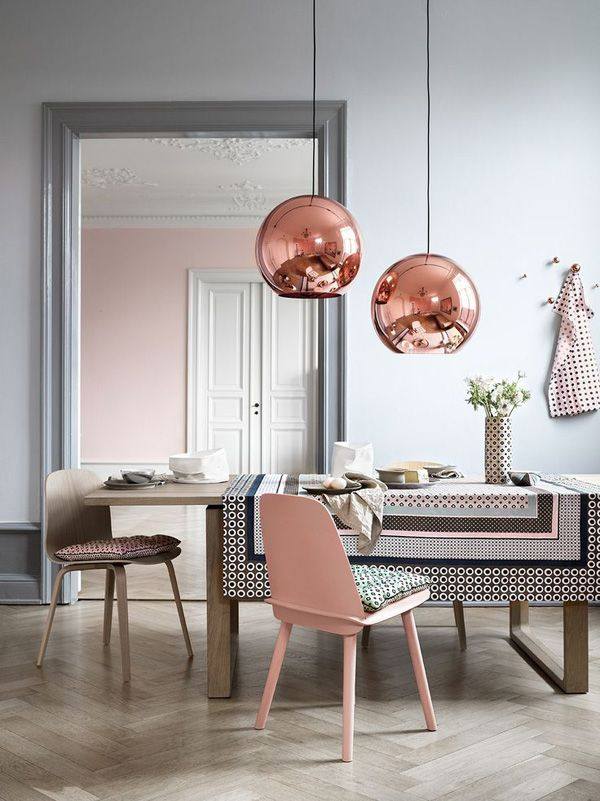 Parquet flooring, pale grey walls and rustic wood paired with copper and pale pink decorative accessories