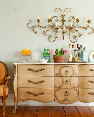 Megan Camp image. Love the vintage dresser as buffet with gold scrolly candleabra piece over it.