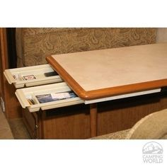 Add slide out drawers to an RV table. | 44 Cheap And Easy Ways To Organize Your RV/Camper