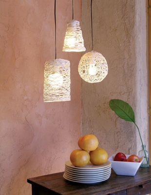 DIY Pendant Light Fixtures made from string dipped in glue and wrapped around a balloon or cone...would be cute with twine