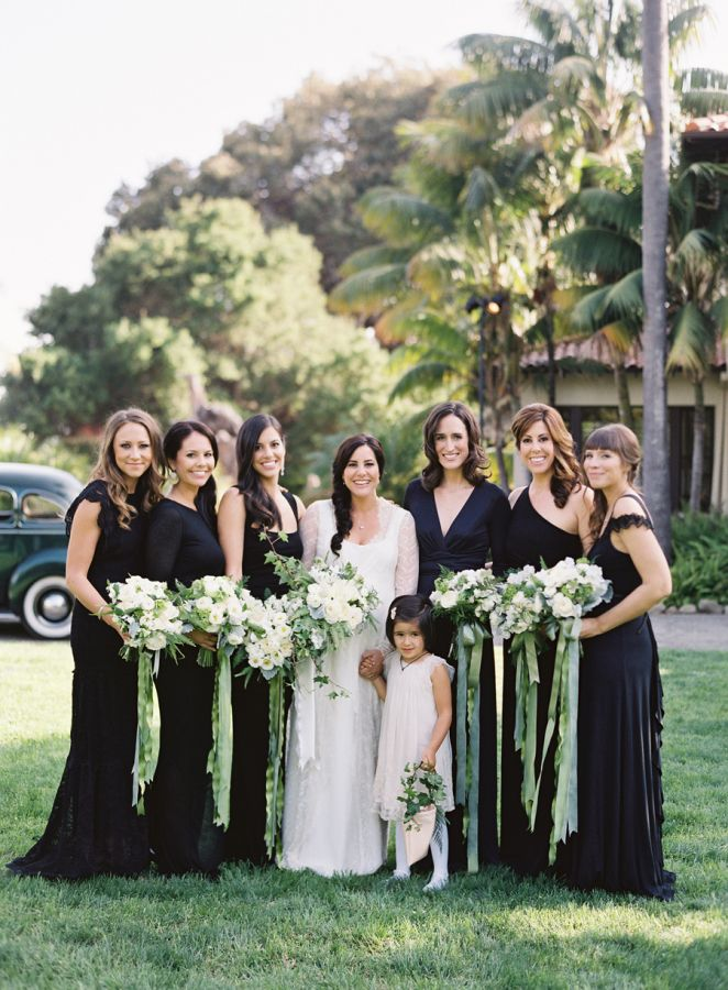 Bridesmaids black mixed dresses white flowers