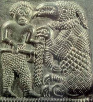 The Norse god Tyr and Fenrir, from a Viking carving from eighth century Sweden. Tyr sacrifices his hand to entice Fenrir wolf into bondage: the warrior often gives profoundly of himself to secure the safety of the community he is sworn to defend.