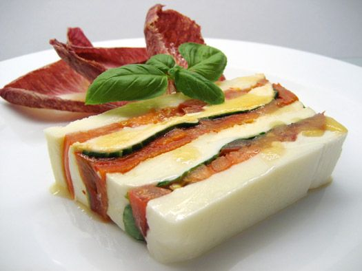 a slice of the finished mozzarella terrine - need to use larger tomatoes and cut them quite thinly - also mozz layer in the middle is important for stability