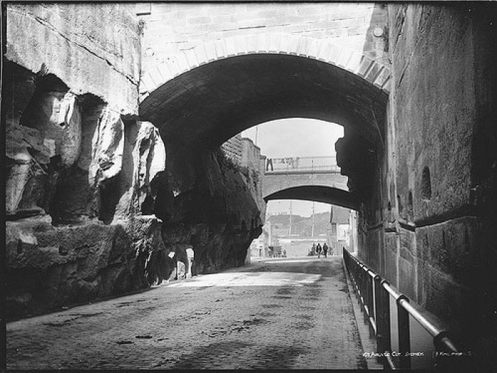 The Argyle Cut. The Argyle Cut It was carved by convicts. Pass through it from the Rocks into almost forgotten Miller's Point (Image courtesy of: The Powerhouse Museum)