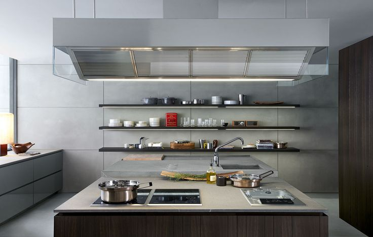 Worktop with modular hobs. On the wall, shelves in spessart oak with integrated lighting system.