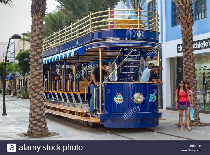 Streetcar conductor directs tourists in Oranjestad Aruba