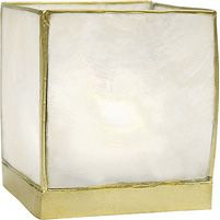 White Capiz Wholesale Candle Holder (gold edged).  2.5 inches x 2.5 inches x 2.5 inches high. Made of natural sea shell from the windowpane oyster, these light and delicate candle holders are hand-crafted in the Philippines. Each piece of shell is hand-cut and wrapped in gold foil for an especially exotic look. Beautifully translucent and opalescent, they provide a soft and shimmery candlelight glow. We recommend the use with tealight candles with these holders.