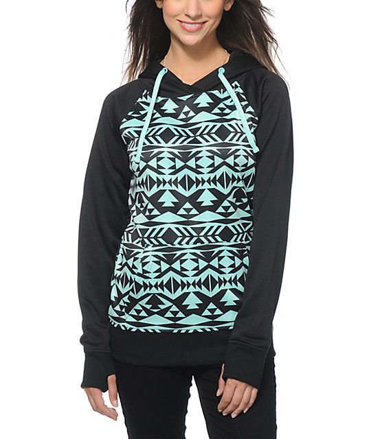 A trendy black and mint tribal print body is accented by a solid hood, raglan sleeves and trim, while the soft fleece lining offers premium comfort.