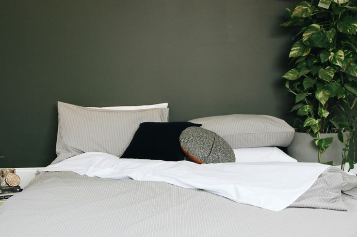 Dramatic, moody bedroom. Beautiful, minimalist bed linen for a simpler, more comfortable life.  Free Australia-wide shipping, 100 night trial.  Shop now.