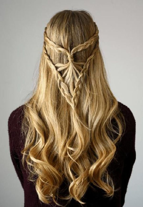 This intricate braid falls down on lovely curls and it might be the best hairstyle you'll have in weeks or even months.