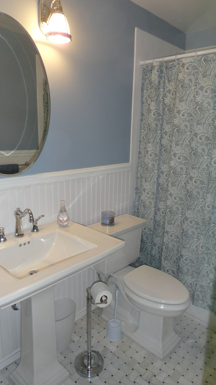 Pedestal Sinks And Toilet Paper Stand Guest Bathroom