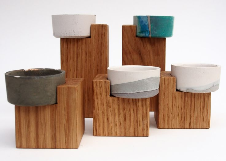YenChen YaWen Studio combined Jesmonite with metal powders to create a series of candle holders that oxidise and change colour as they age