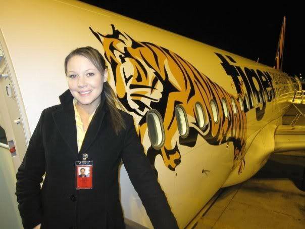 Tiger Airways Cabin Crew in doorway of A320 Aircraft