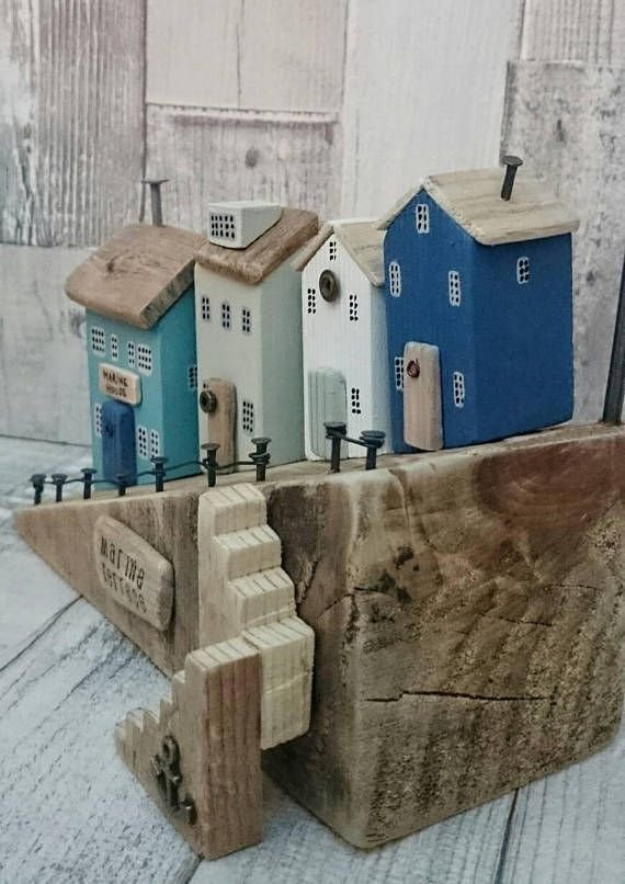 MARINE TERRACE Original Artwork by DriftwoodSails This wood sculpture has been lovingly handcrafted using salvaged wood, weathered driftwood, chalk paint, nails, wire, washers. It is set on a gorgeous piece of driftwood found on the Kent coast. A harbour scene of wooden houses