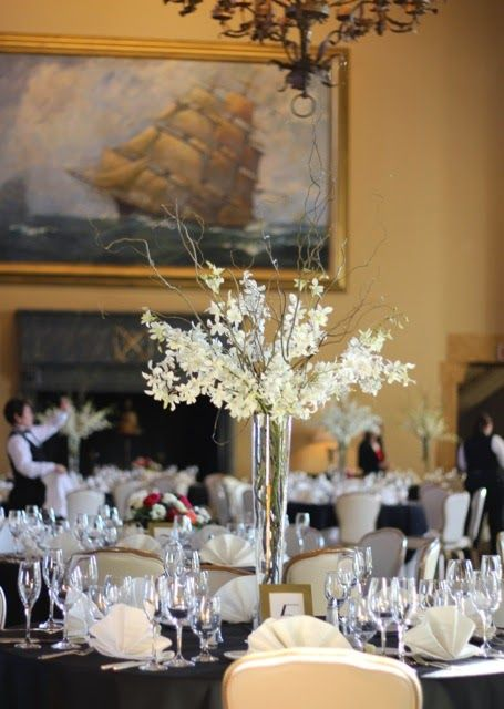 Elevated centerpiece by sweet pea floral design featuring