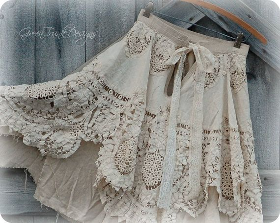 A sweet and romantic skirt handmade from vintage lace. This skirt has two layers. The top layers is made of tattered vintage battenburg lace.