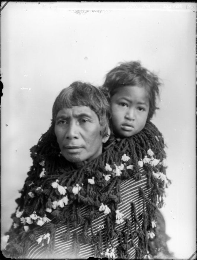 Maori woman carrying a baby on her back - Photograph taken by William Henry Thomas Partington