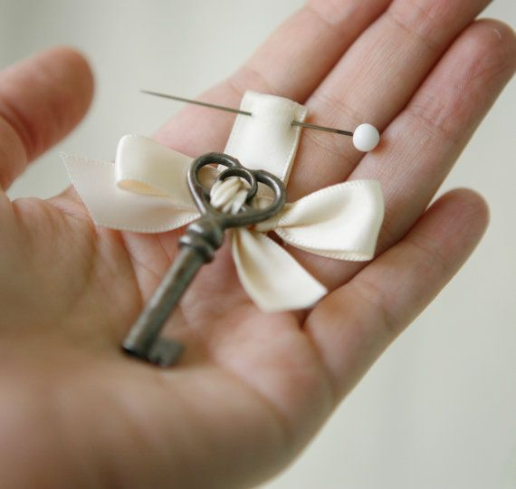 Something different for the groom. He wears a key on his boutonniere and She has the lock the key fits on her bouquet.