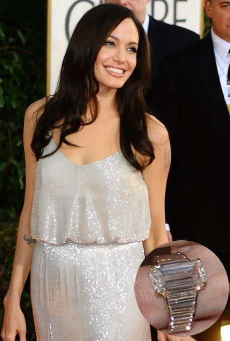 Angelina Jolie's engagement ring was designed by jeweler Robert Procop, who worked closely with Brad Pitt for about a year to create something that spoke to both Brad and Angie's sophisticated yet edgy sensibilities. The table-cut ring has an estimated value of $500,000, boasting a total weight of 16 carats with a center stone of 7 carats. A predecessor to the emerald- and square- cut stones, a table-cut diamond has a flat top, just like a table. See engagement rings with a similar to…