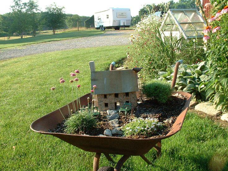miniature garden in an old wheelbarrow.