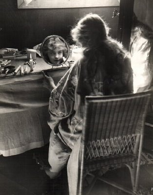 Lillian Gish 1893 – 1993  Doing her make up by candlelight!  vintage Hollywood stars and burlesque performers at their dressing tables. I love the way that each woman's femininity is enhanced by being pictured next to, or using their dressing tables. These photos are a real celebration of star power, glamour and female allure...