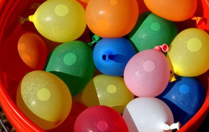Water Balloons in Bucket - throw or slingshot water balloons and see if teammate can catch them in a bucket
