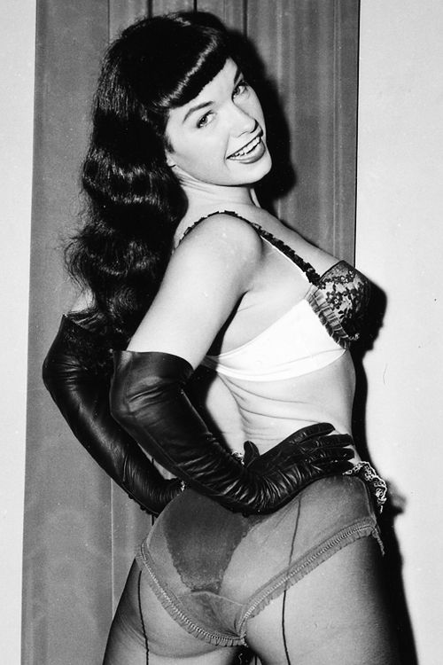 Bettie Page photographed by irving Klaw c. 1950s - unfortunately i don't know who bettie page is, but she looks like Barbie Benton's sister