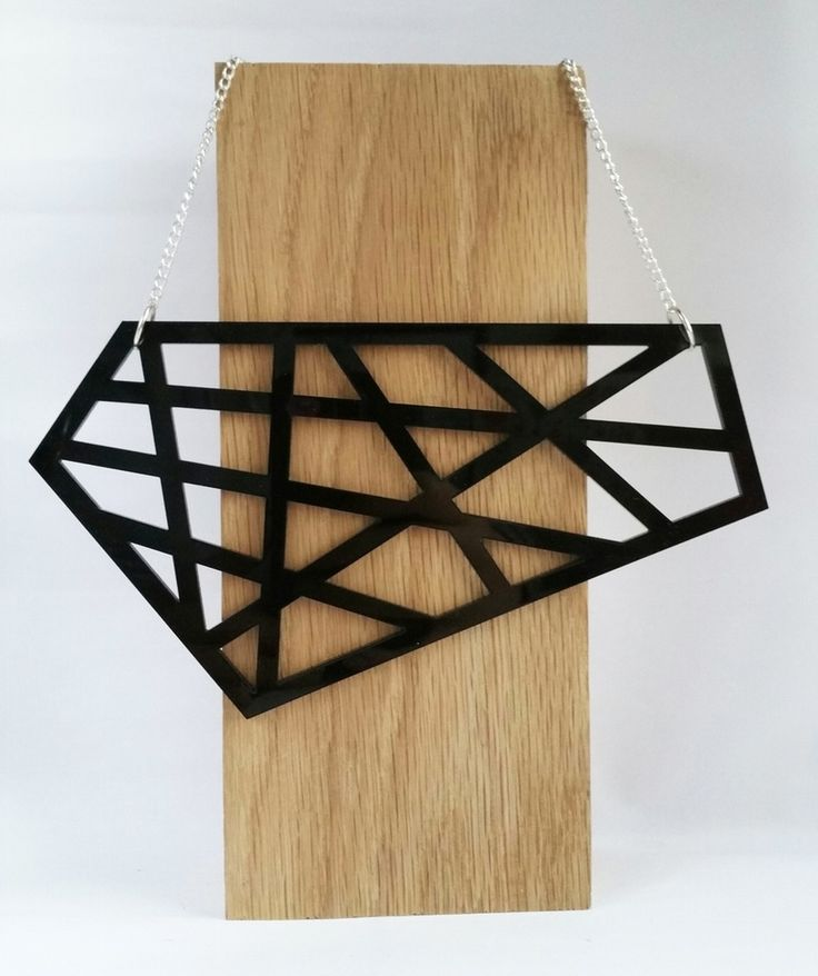 Truly stand out from the crowd in this eye-catching geometric asymmetrical neckacle. The large laser cut pendant hangs from a silver plated curb chain and features an Emmie Lou brand tag.Measurements: 21 cm W x 8 cm H 40 cm chainMaterial Details: Laser cut perspex.Silver plated curb chain and fixtures. Nickle Free.Please avoid contact with water and perfumes. Shipping is based on standard postage from Ireland.