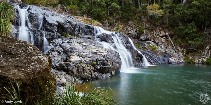 The top section of the beautiful two-part waterfall at Booloumba Falls provides a paradisiacal backdrop to a series of crystal clear pools.