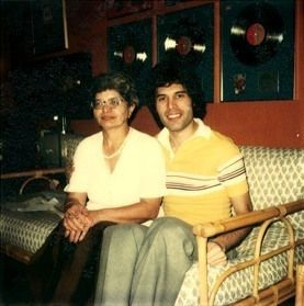 Photo of Freddie  With parents Jer and Bomi Bulsara in the early 1980s for fans of Freddie Mercury.